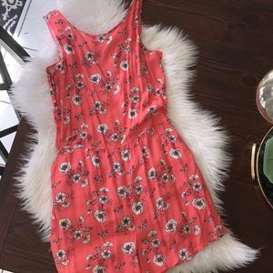 Romper with open back and button detail